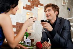 Young happy couple romantic date drink glass of Stock Images
