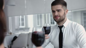 Young happy couple romantic date drink glass of red wine at restaurant, celebrating valentine day stock footage