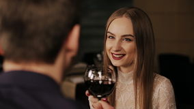 Young happy couple on romantic date drinking glass of red wine stock video