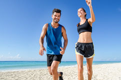Couple running at the beach stock photography