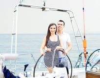 Young and happy couple of a sailing boat Stock Photography