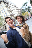 Young happy couple screaming of happiness in the streets Stock Image