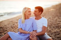 Young happy couple on seashore. royalty free stock images
