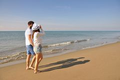 Young happy couple on seashore. Male has beard. Stock Images