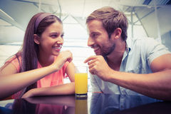 Young happy couple sharing a drink Stock Photos
