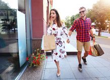 Young happy couple with shopping bags in the city Royalty Free Stock Image