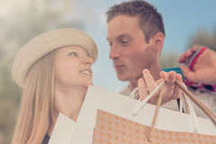 Young happy couple with shopping bags in the city. Young happy couple Stock Photography