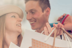 Young happy couple with shopping bags in the city. Young happy couple Stock Photos