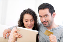 Young happy couple shopping on a tablet Royalty Free Stock Image