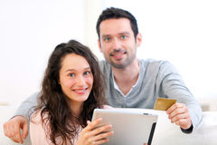 Young happy couple shopping on a tablet Stock Photo