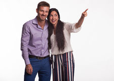 Young happy couple showing by hands Royalty Free Stock Photography