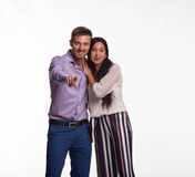 Young happy couple showing by hands Royalty Free Stock Photos