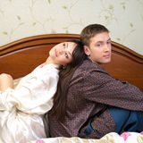 Young happy couple sitting on Royalty Free Stock Photos