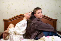 Young happy couple sitting on royalty free stock photo