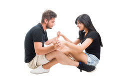Young happy couple sitting and facing each other Royalty Free Stock Photo