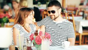 Young happy couple sitting in a street cafe on their vacation Stock Photo