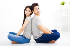 Young happy couple sitting together Royalty Free Stock Photos
