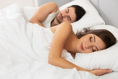 Young happy couple sleeping in bed Stock Photo