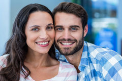 Young happy couple smiling at the camera Stock Images
