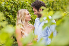 Young happy couple smiling and embracing each other Stock Photography