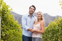 Young happy couple smiling and looking in the distance Royalty Free Stock Image
