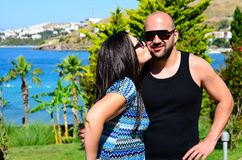 Young   happy couple. Young  smiling  tanned  happy couple  kissing on tropical garden in a luxurious resort Stock Photos