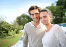 Young happy couple standing oudoors Stock Photo