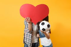Young happy couple supporter, woman man, football fans cheer up support team, kissing behind red heart love, soccer ball royalty free stock photo