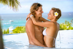 Young  happy couple in swimming pool Royalty Free Stock Photo