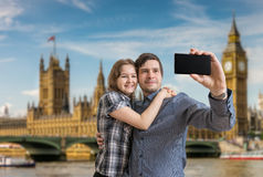 Young happy couple is taking selfie photo in London Stock Images