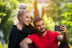 Young couple taking a selfie with smart phone. royalty free stock image