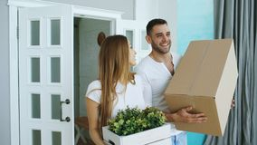 Young happy couple talking while standing at their new house Stock Photo