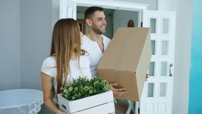 Young happy couple talking while standing at their new house Royalty Free Stock Image