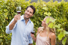 Young happy couple talking about wine Royalty Free Stock Photos