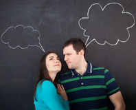 Young happy couple thinking. Chalk drawing Stock Images