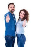 Young happy couple thumbs up isolated on white. Background Stock Photography