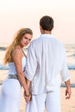 Young happy couple at tropical beach Royalty Free Stock Photos