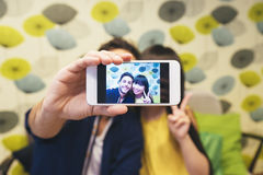 Young happy couple using smartphone in the bar. They are in coffeshop Royalty Free Stock Image
