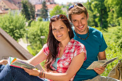 Young happy couple on vacation with map Royalty Free Stock Images