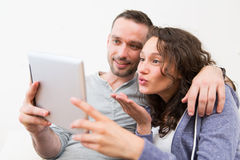 Young happy couple video calling on tablet Royalty Free Stock Image