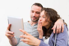 Young happy couple video calling on tablet stock photos