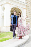 Young happy couple walking in city Royalty Free Stock Photos