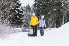Young happy couple walking in winter park Stock Photo