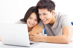 Young happy couple watching the laptop Stock Photography