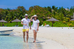 Young happy couple on white beach at summer stock images