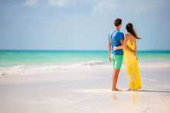 Young happy couple on white beach at summer vacation. Young happy couple have fun during beach vacation Stock Photography