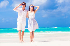 Young happy couple in white at tropical beach Stock Photo