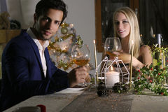Young happy couple with a wine glasses at celebration Stock Image