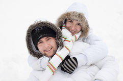 Young happy couple in winter. Young happy couple in snowy mountains. Winter sport vacation Royalty Free Stock Photos