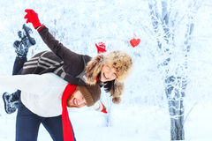 Young happy couple in winter forest Royalty Free Stock Images